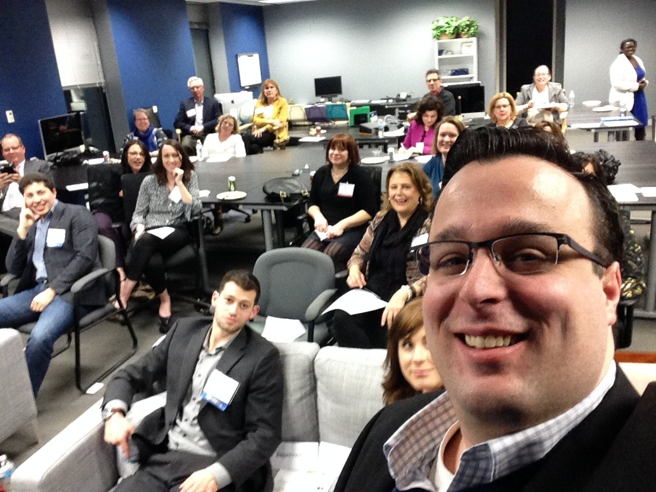 Group of people where Scott Winterroth takes selfie with group of attendees behind him